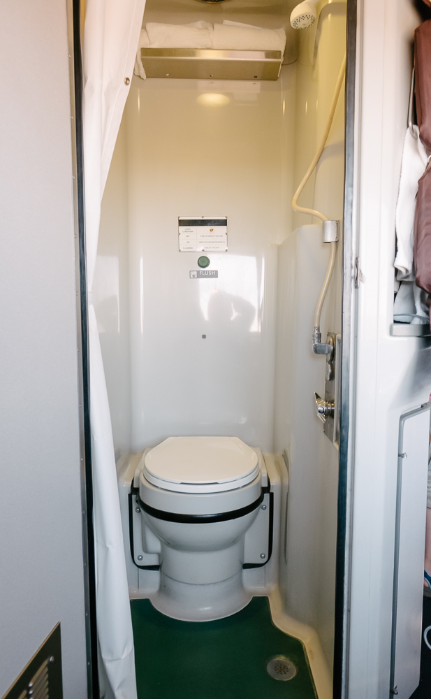 Tiny private bathroom and shower in an Amtrak bedroom